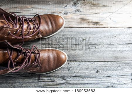Close up view of brown leather man or woman new dry clean shoes, showing laces in detail.Texture backdrop Unisex style. Top view