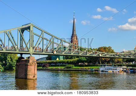 FRANKFURT, GERMANY - AUGUST 28, 2014: The Eiserner Steg - old iron bridge over the river Main in Frankfurt