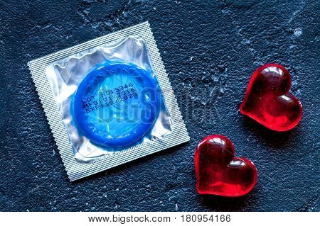 concept male contraception condom on dark background top view.