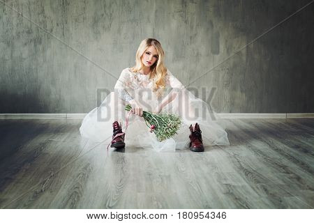 Creative Fiancee Woman Wearing White Dress Sitting on a Parquet Floor. Fashion Model in White Bridal Gown