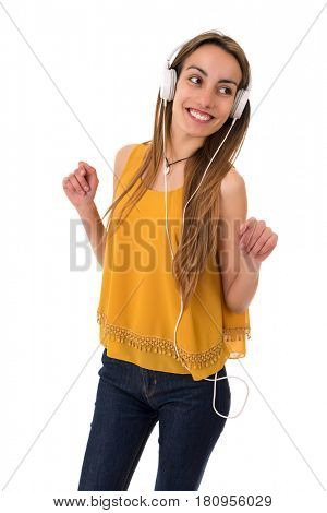 Beautiful young woman listen music with headphones, isolated on white