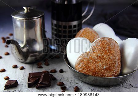 gingerbread in shape of heart frosting with tea and coffee making facilities