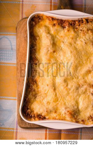 Lasagne cooked at home in large form for baking on tablecloths vertical