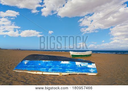 Valencia La Malvarrosa beach arenas beached boats in Spain