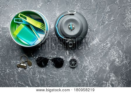 Traveler's accessories, loudspeaker and sunglasses in vacation concept on gray table background top view