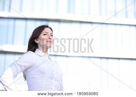 Portrait of a successful business woman smiling. Beautiful female executive in an urban setting