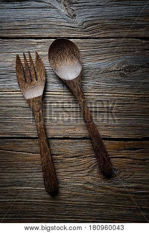 wooden kitchen tools spatules spoon and fork kitchenware on wooden background