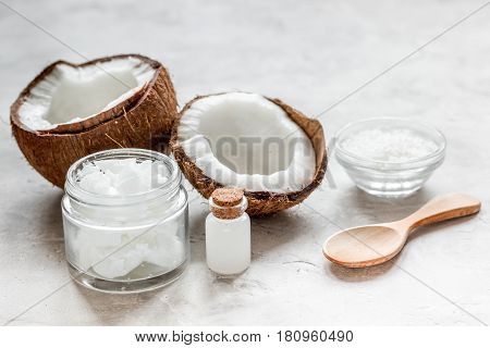 organic cosmetic concept with fresh coconuts and body cream on white table background