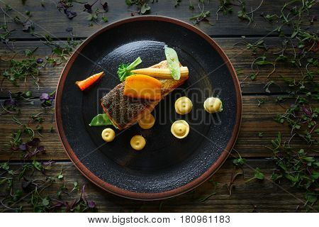 Braised Norwegian salmon with curry apple and watercress