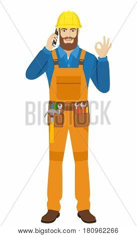 Worker talking on the mobile phone and shoing a okay hand sign. Full length portrait of worker character in a flat style. Vector illustration.