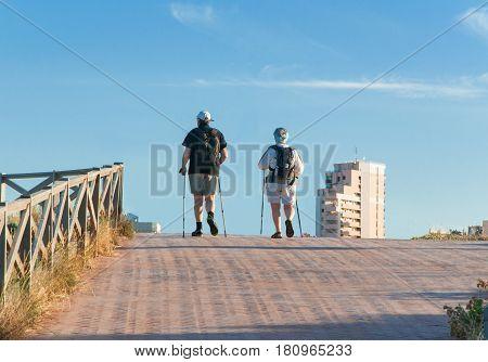 Nordic Walking - elderly woman and man is hiking