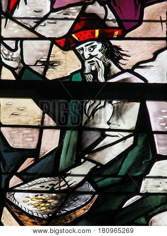 Stained Glass - Man Counting Money