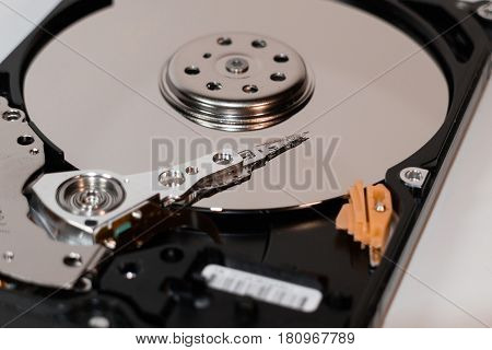 hard disk drive inside. magnetic head magnetic surface of the disk