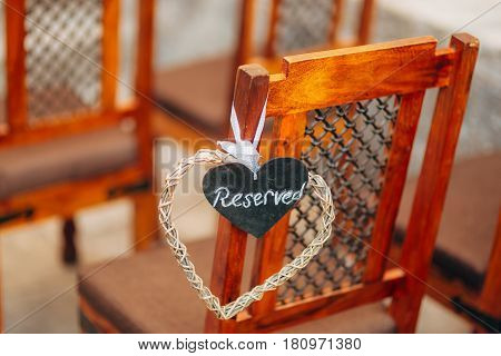 Plate Reserved on the chair at the wedding. Chairs at the wedding ceremony. Wedding in Montenegro.