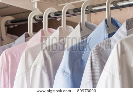ironed shirts in the closet organize closeup