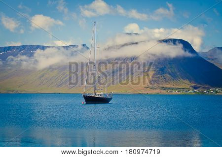 Beautiful view of icelandic fjord and city in iceland with red houses, ships and yachts, Iceland