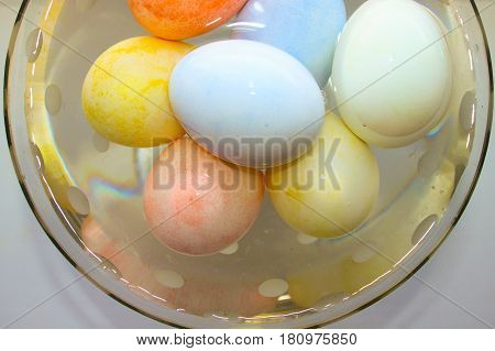 Easter Eggs Are Tender In A Glass Vase With Water