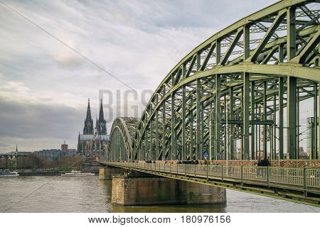 View on Cologne Cathedral and Hohenzollern Bridge over the Rhine river,