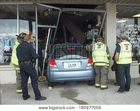 OCTOBER 2, 2013. CASPER, WY.  CIRCA:  Old female driver was confused and drove her car into a store in the shopping mall.