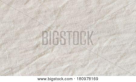 Vintage beige fabric texture background. Flax canvas close-up burlap.