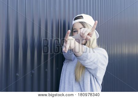 Young Swag Girl Gesturing In The Street.
