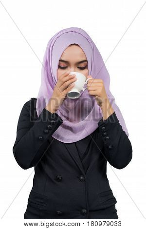 Beautiful modern Young Asian Muslim business woman drinking coffeeisolated on white background.