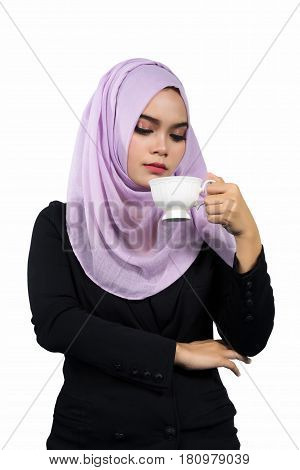 Beautiful modern Young Asian Muslim business woman holding a white coffee cupisolated on white background.
