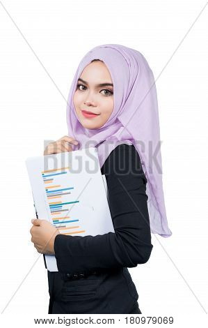 Beautiful modern Young Asian Muslim business woman holding reportsisolated on white background.