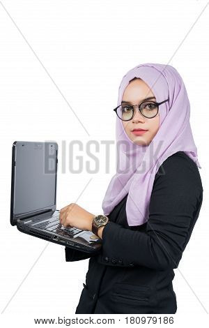 Beautiful modern Young Asian Muslim business woman presenting works on a notebookisolated on white background.