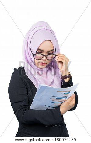 Beautiful modern Young Asian Muslim business woman looking the reportsisolated on white background.