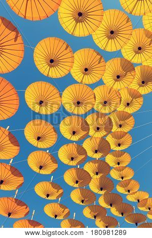 Decoration by colorful umbrella with sky background.