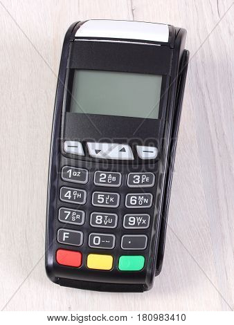 Payment Terminal, Credit Card Reader On Wooden Background, Concept Of Cashless Paying For Shopping