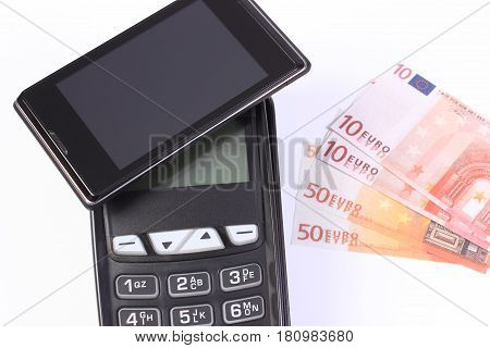 Payment Terminal With Mobile Phone With Nfc Technology And Currencies Euro, Concept Of Cashless Payi