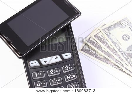 Payment Terminal With Mobile Phone With Nfc Technology And Currencies Dollar, Concept Of Cashless Pa