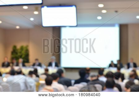 Business meeting and audience in the conference hall with copy space on white screen blur background, business conference and presentation.