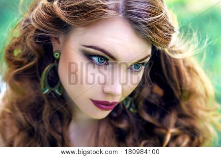 Young red-haired beautiful girl with green eyes makeup