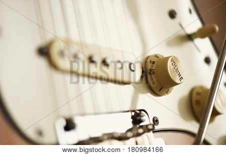 detail of electric guitar - volume control focused macro