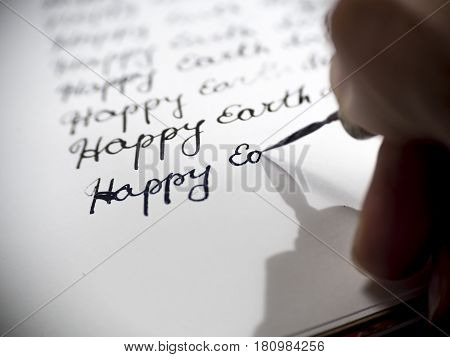 Happy earth day calligraphy and lattering typographical design.