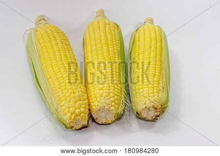 sweet corn on cobs kernels on white background corn vegetable isolated.Organic corn is a vitamin C food,magnesium-rich food & contains certain B vitamins & potassium.