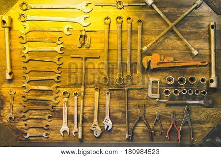 The old tool hanging on the board.The tool room in retro style