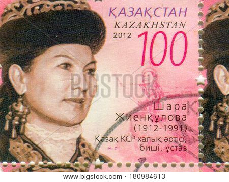 GOMEL, BELARUS, APRIL 8, 2017. Stamp printed in Kazakhstan shows image of  The Shara Zhienkulova (July 18, 1912 - May 21, 1991) is a Kazakh Soviet dancer and teacher, circa 2012.
