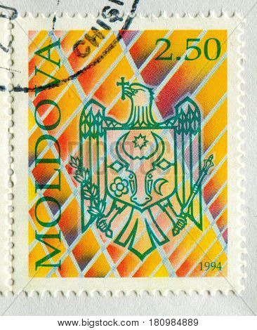 GOMEL, BELARUS, APRIL 7, 2017. Stamp printed in Moldova shows image of  The coat of arms Moldova, circa 1994.