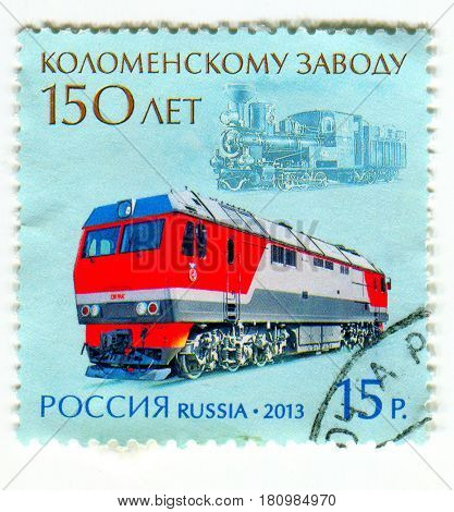 GOMEL, BELARUS, APRIL 7, 2017. Stamp printed in Russia shows image of  The Kolomna Locomotive Works (Kolomensky Zavod) is a major producer of railroad locomotives in Russia, circa 2013.