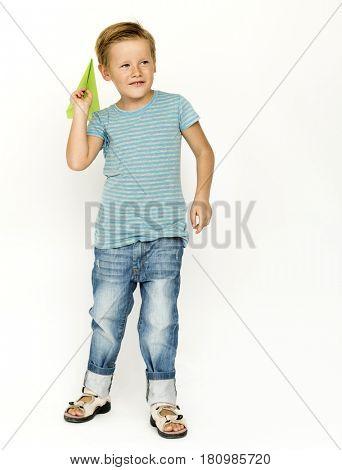 Boy playing paper plane handicraft
