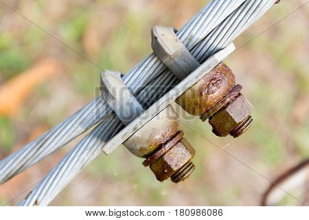 Closeup connection of rusty steel sling wire rope with blurry background