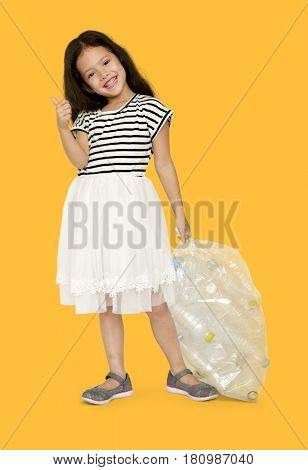 Little Girl Holding Separate Plastic Bottles Studio Portrait