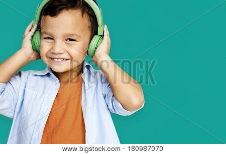 Young asian boy wearing headphones listening to music