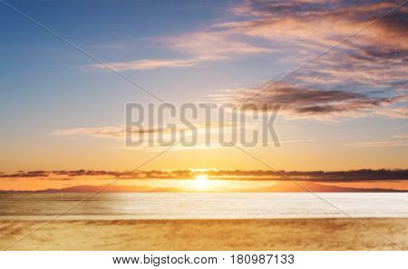 Wooden table top, with blur defocused sky in sunrise backgrounds