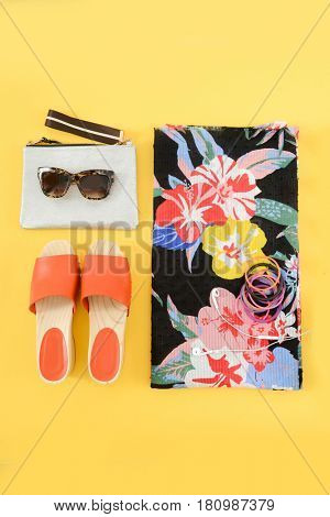 Fashion accessories. Summer outfit, accessories set-yellow background