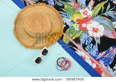 Fashion. Summer woman accessories-Summer floral scarf, shoes,hat, sunglasses,phone,on blue background